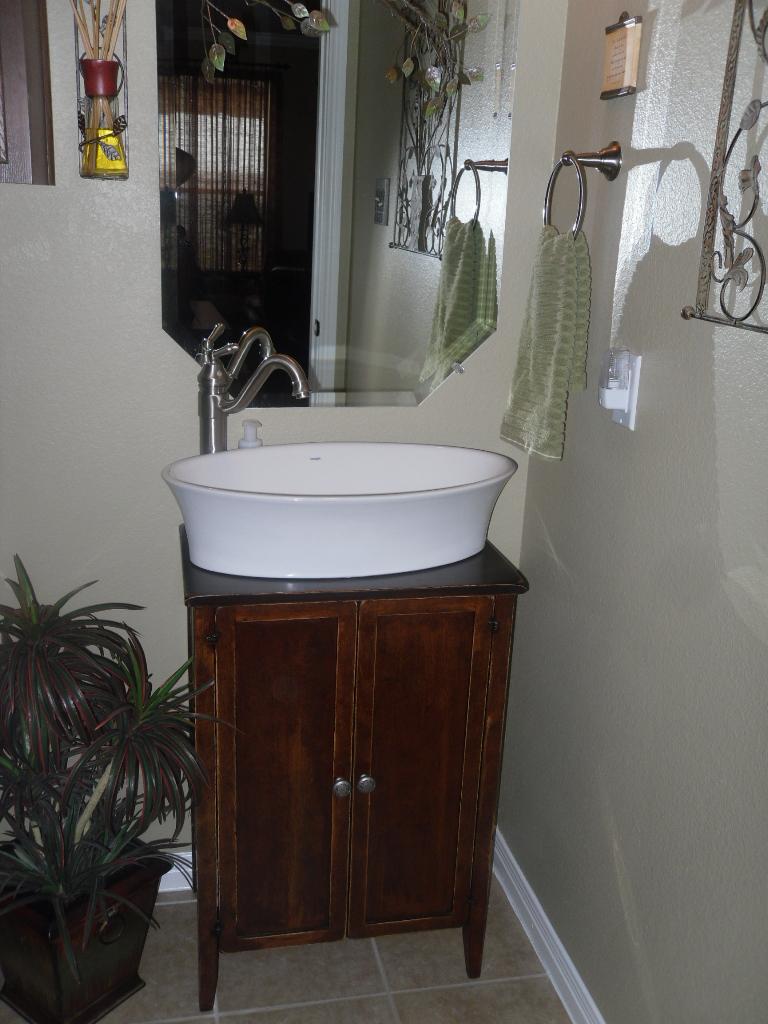 Ovl poceline sink with vintage cabinet base