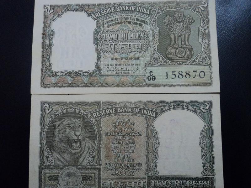 2 rupee half tigre green note