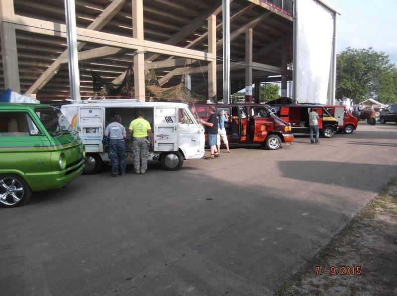 Vans Parked Under Grandstand