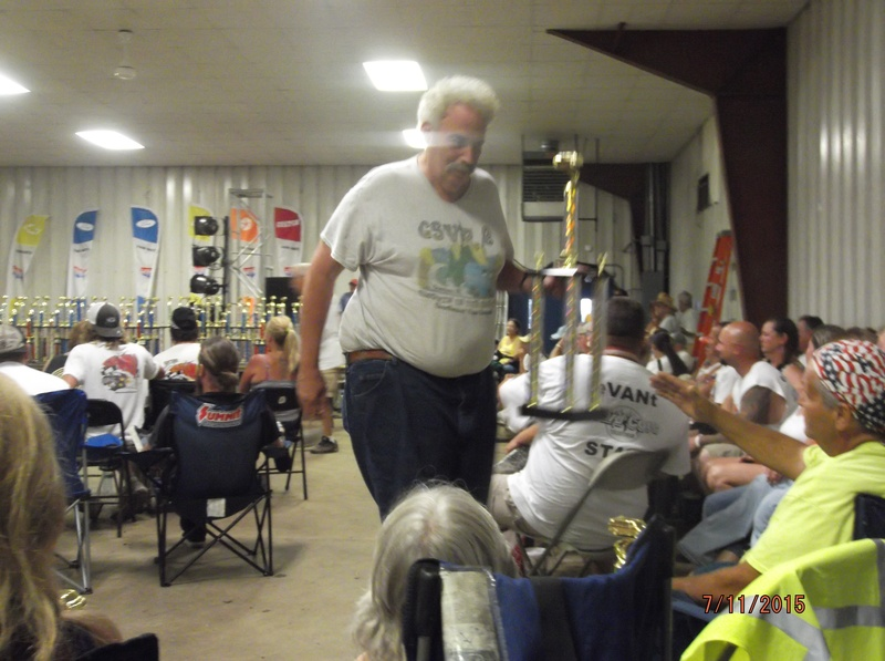Lew Greger and first place trophy