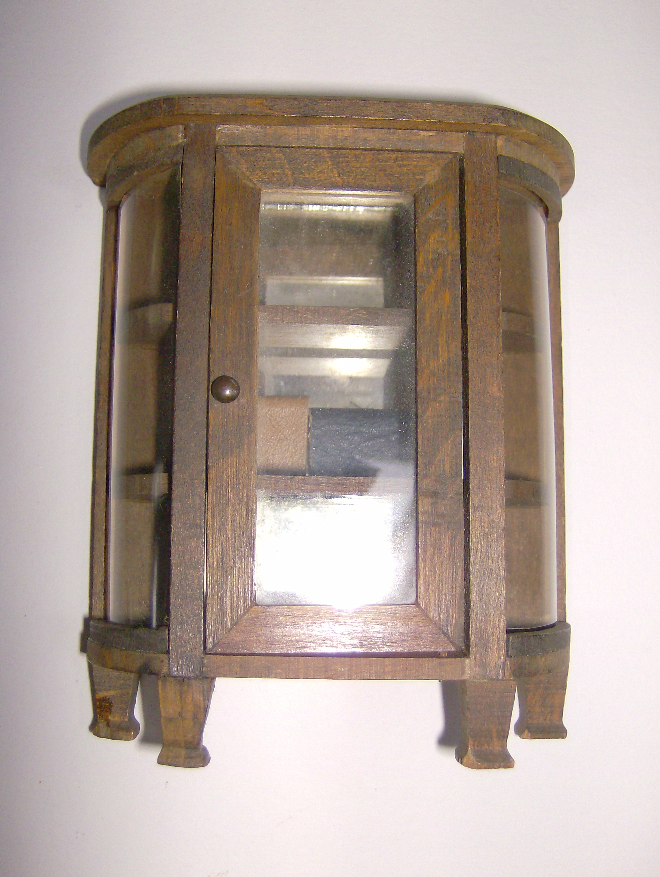 Cupboard with mirror backing.