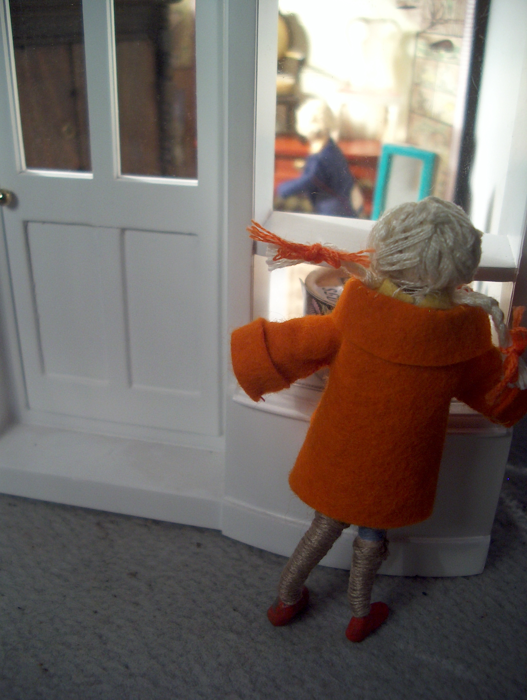 Exploring the village the next day, and seeing a somewhat tatty second hand shop, she pressed her nose ro the window and was most disconcerted to see a familiar face inside the shop.