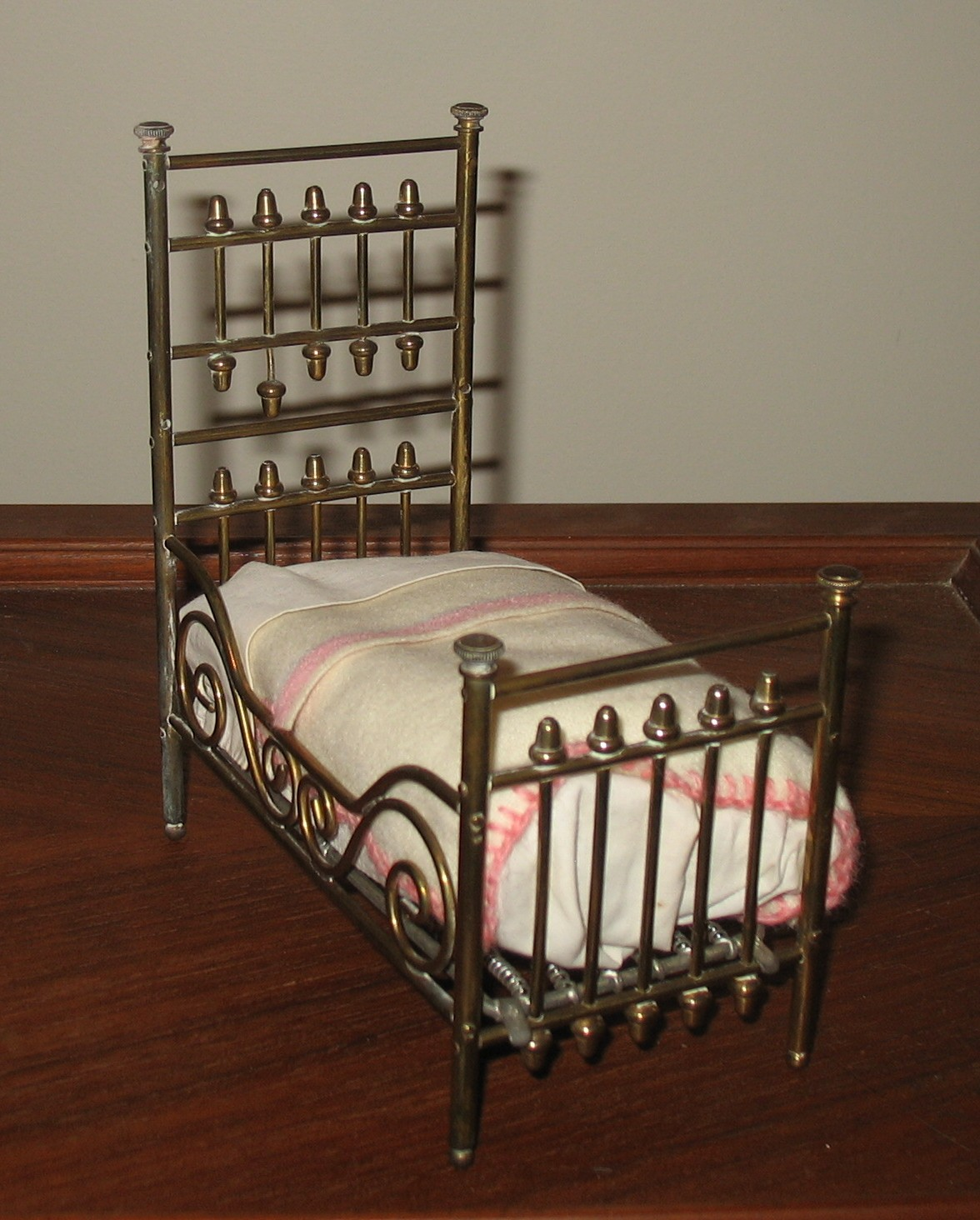 A brass bed with high head