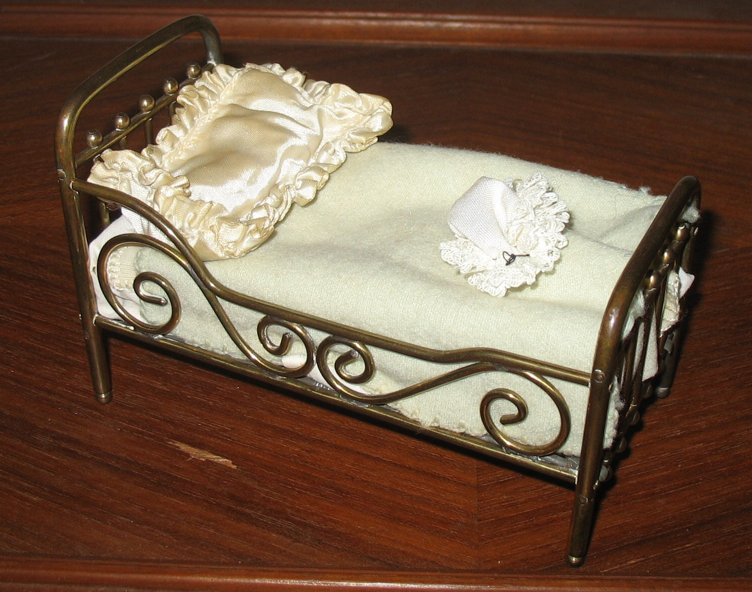 A brass bed with a low head