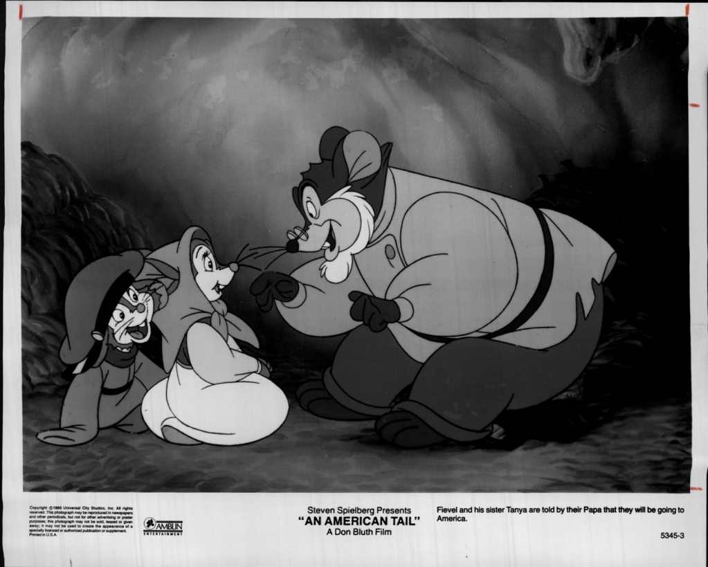 Papa telling Fievel and Tanya about America.