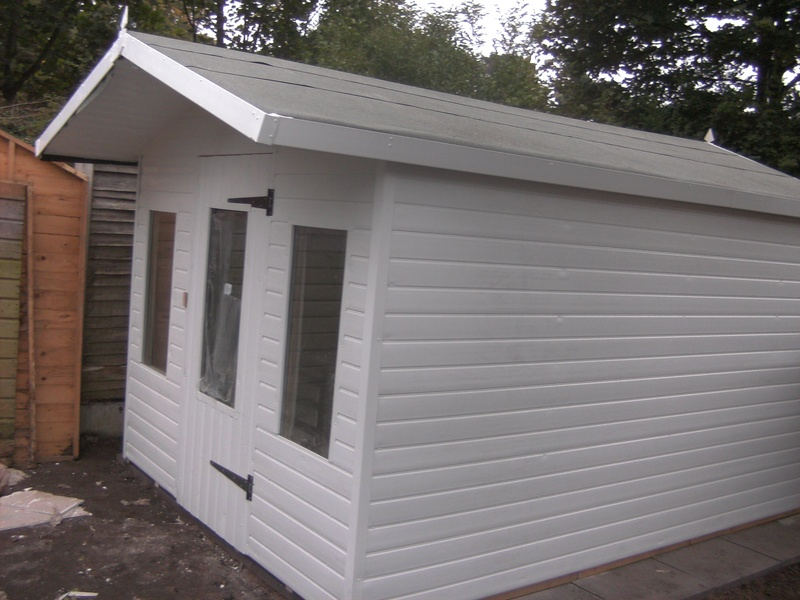 UPVC SHED with extended roof.