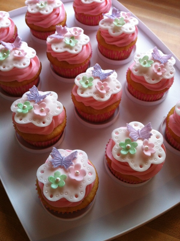 vanilla cupcakes topped with pink cream cheese buttercream and