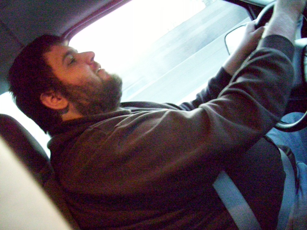 John Koch singing and driving