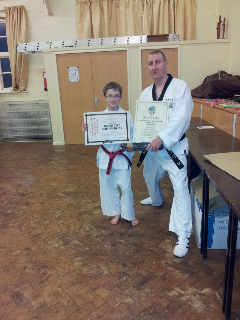 byron receiving his black belt and certificates
