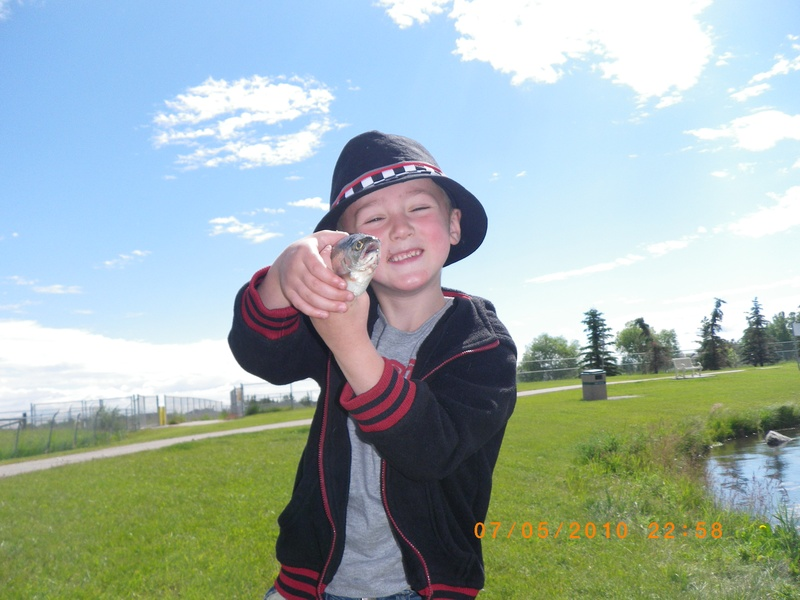 my grandson with his first fish