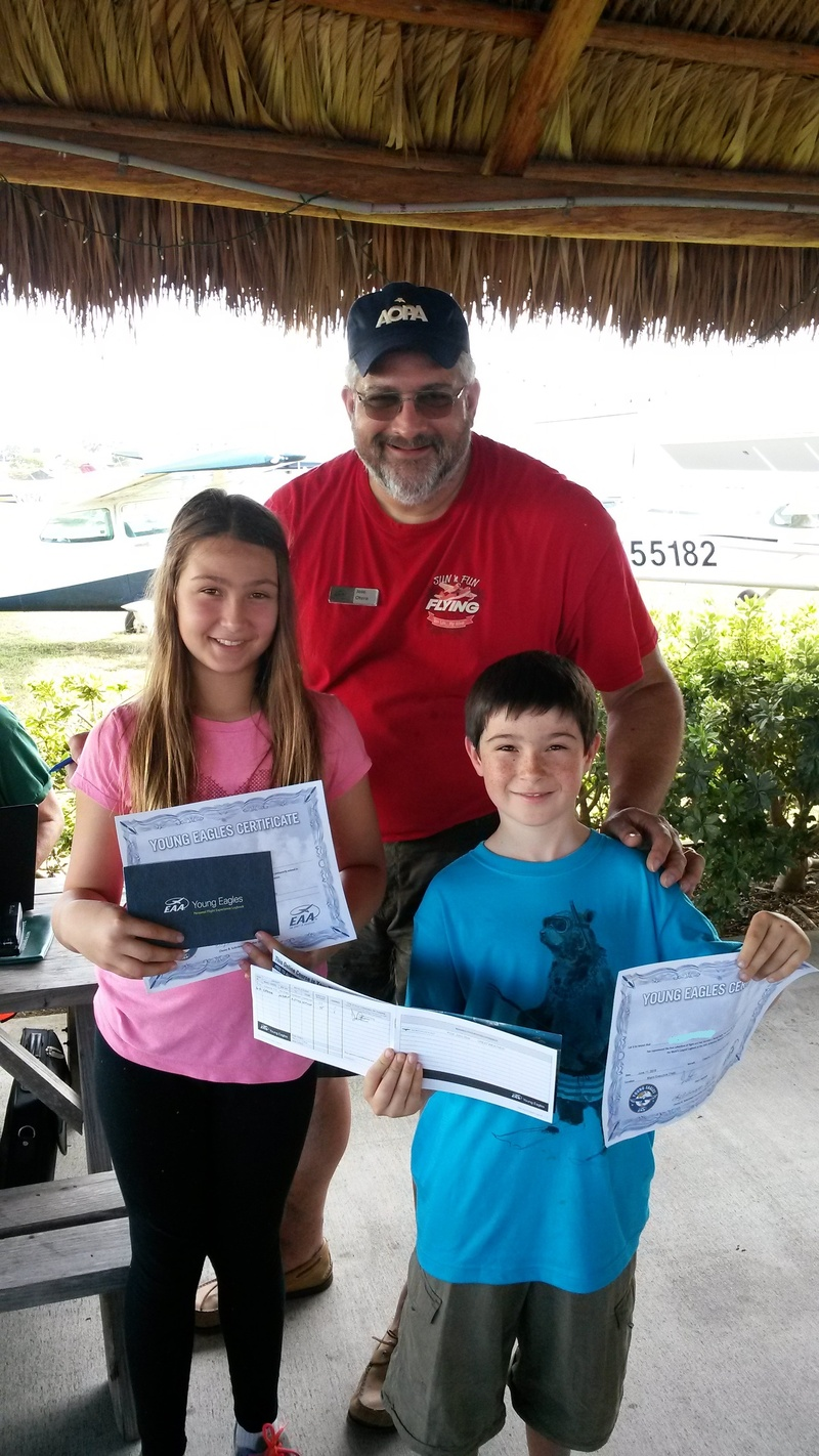 Young Eagles receiving their first flight log book and certificate!