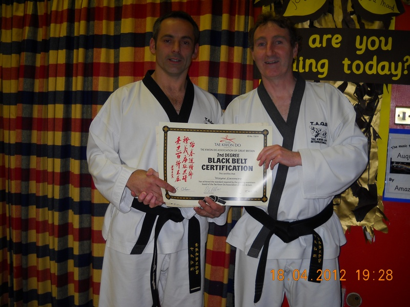 WAYNE RECEIVING HIS 2ND DAN PROMOTION