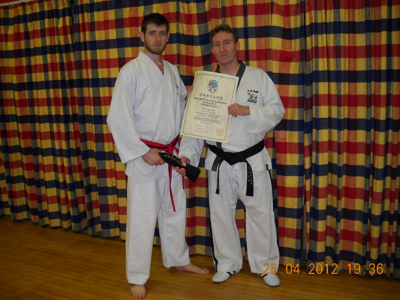 AARON RECEIVING BLACK BELT