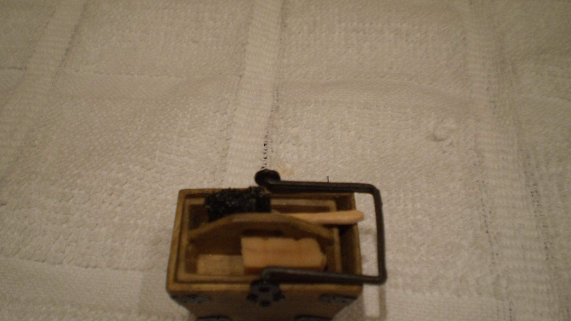Hand brush in housekeepers box.
