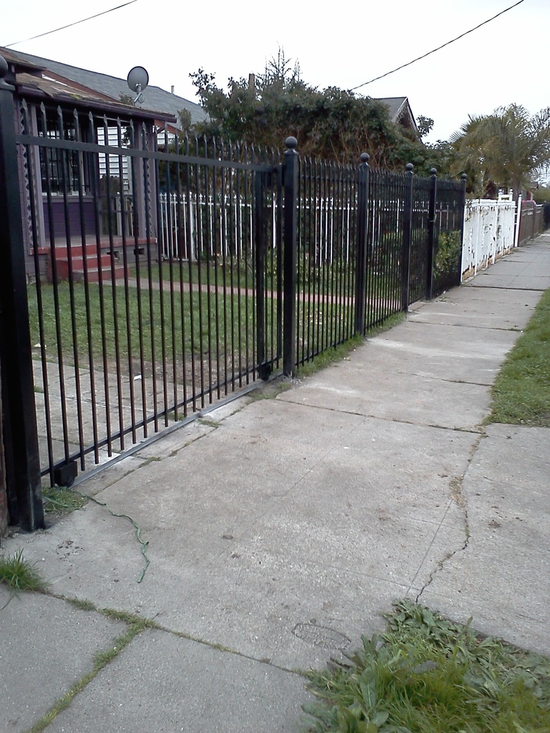 iron gate+ 6 ft high fence