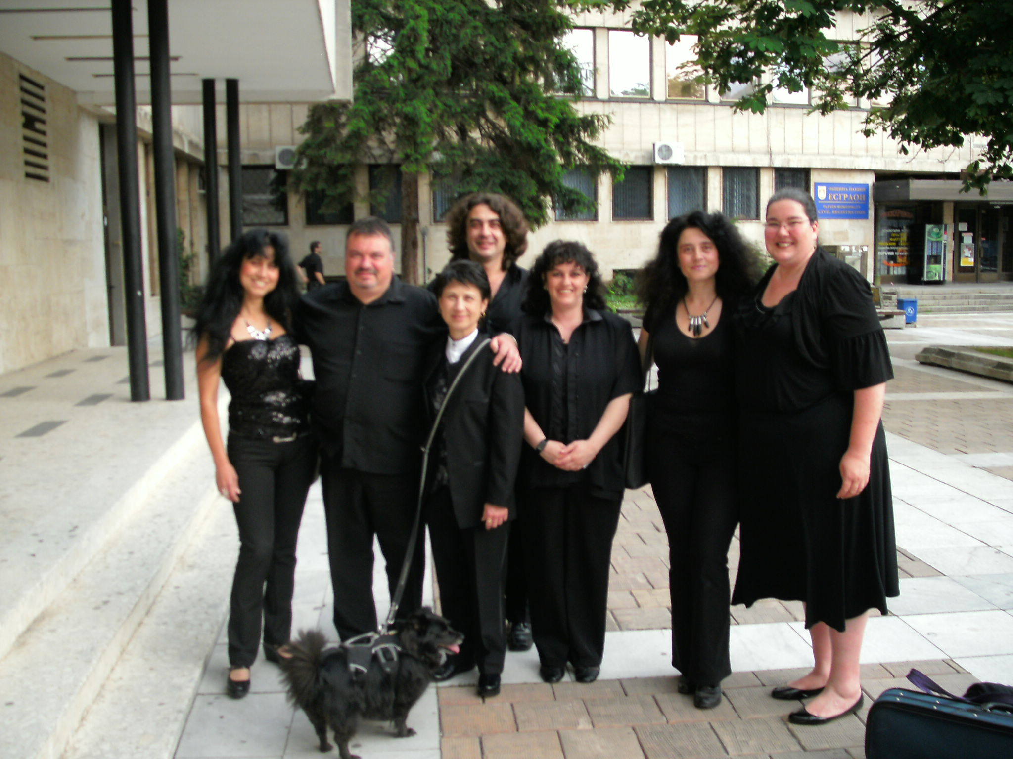 After rehearsal shot of members of the orchestra with Sandra Noriega