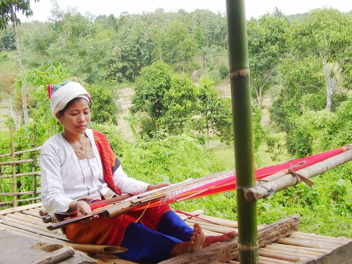 "A Tanchangya woman weaving ""pinoin"", the traditional skirt"