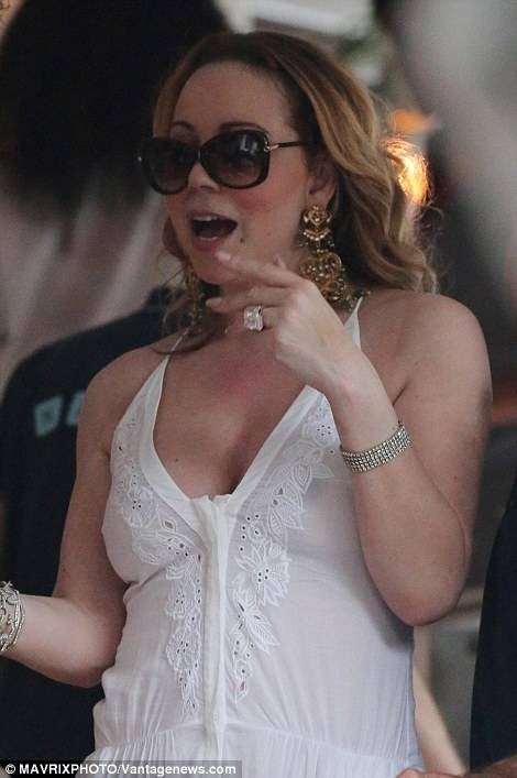 Mariah dazzled in her sheer white gown and glamorous jewels