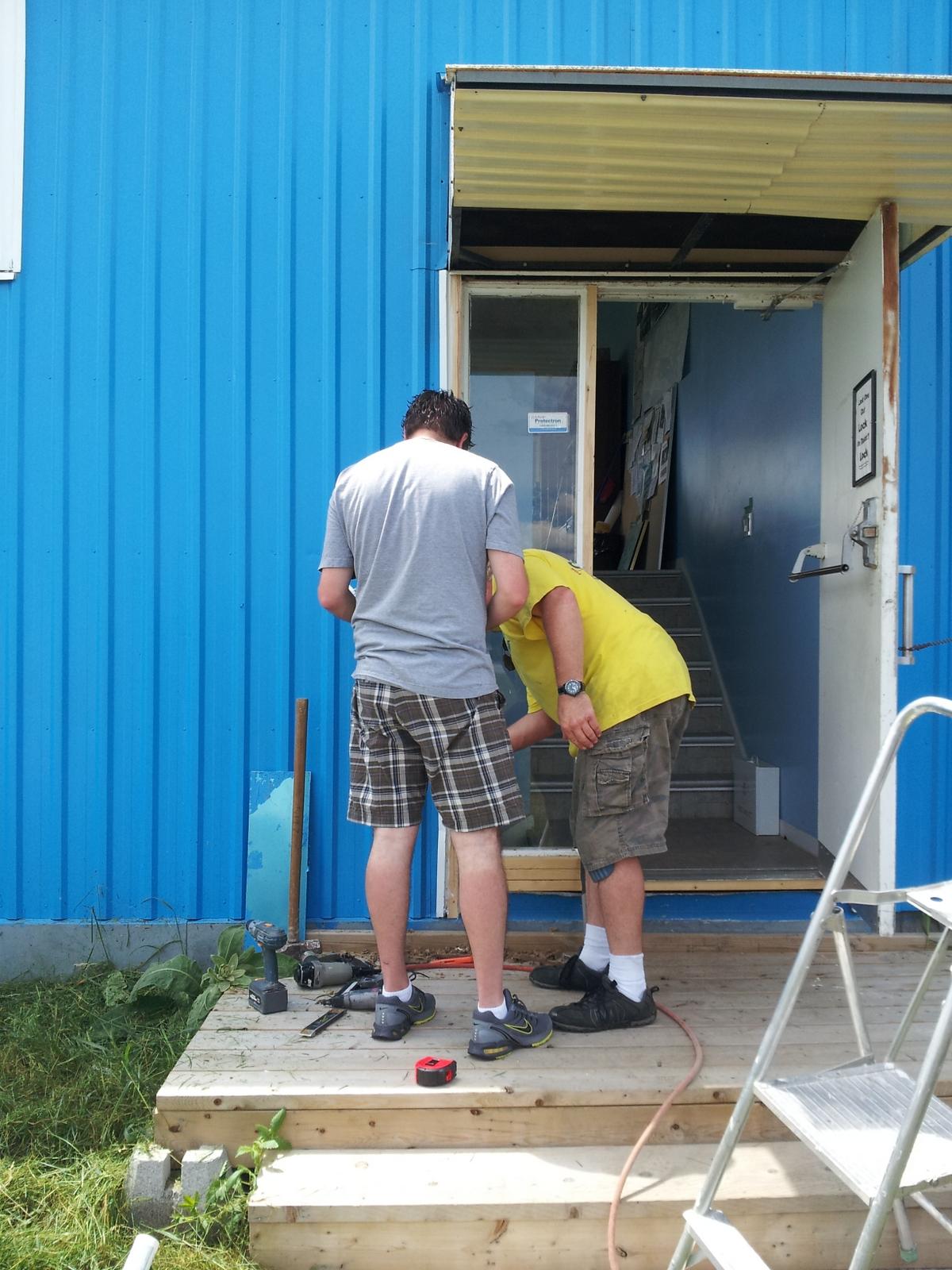 Perry helping Ritz finish up door repair