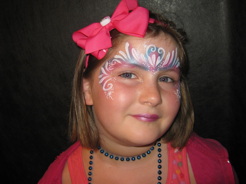 princess like mask tri coloured split cake