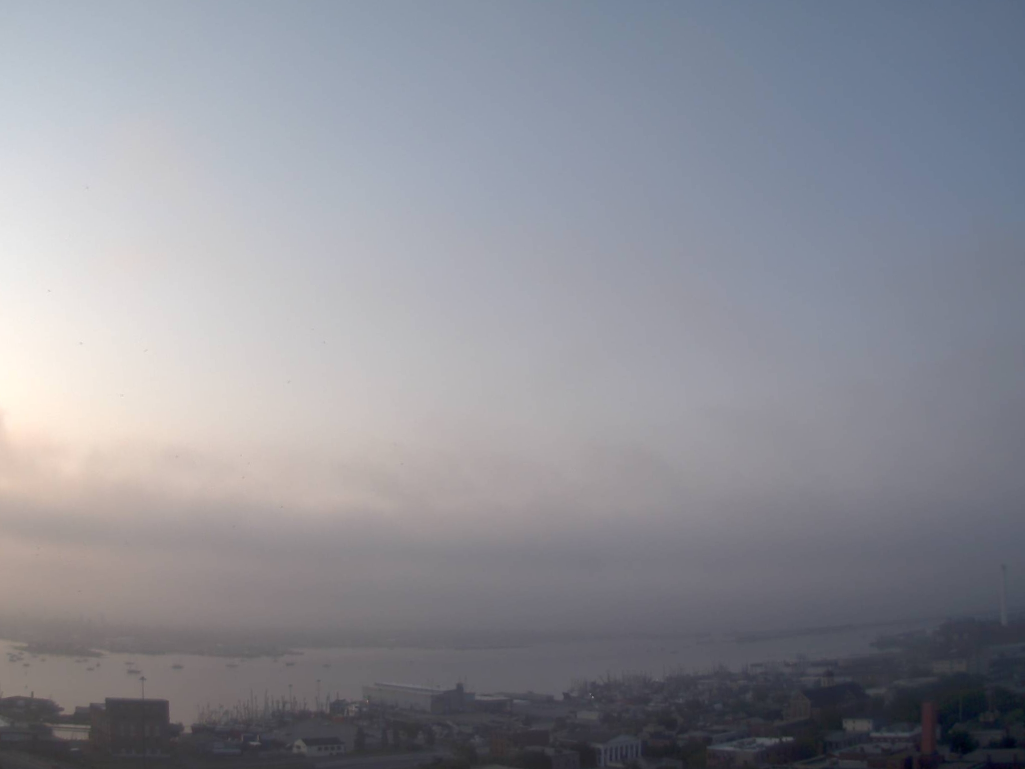 Burning off Fog and Haze over the harbor