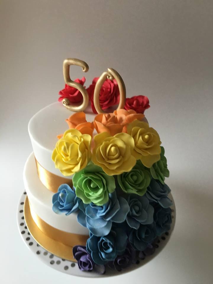 Rainbow themed anniversary cake