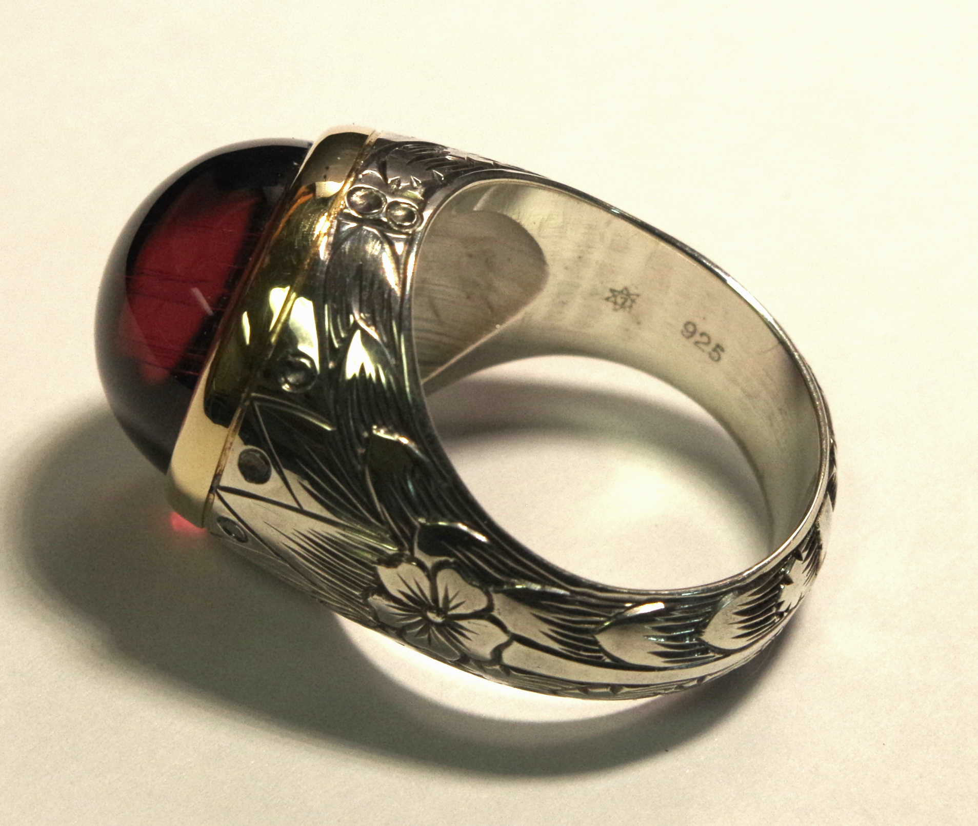 Lady's ring 14KY, Sterling silver, garnet.