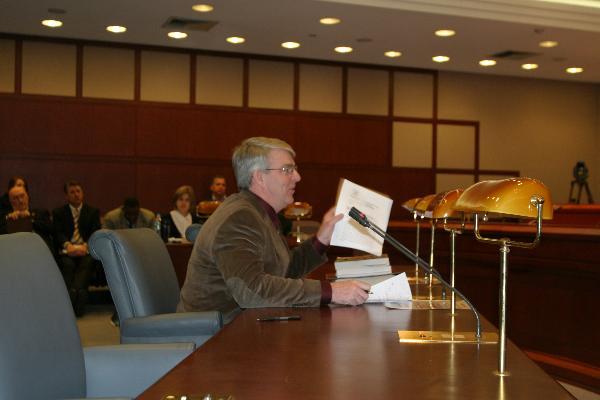 Testifies on Bill