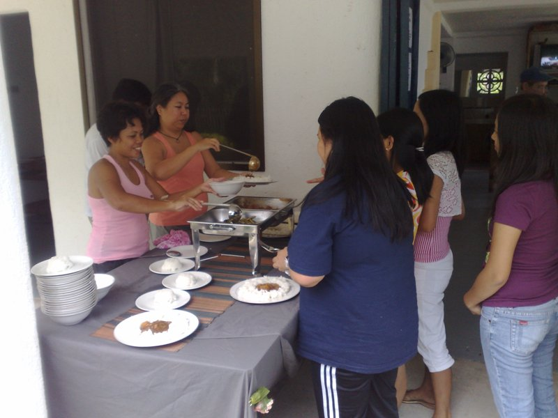 Charmaine and Cyntia serving Lunch