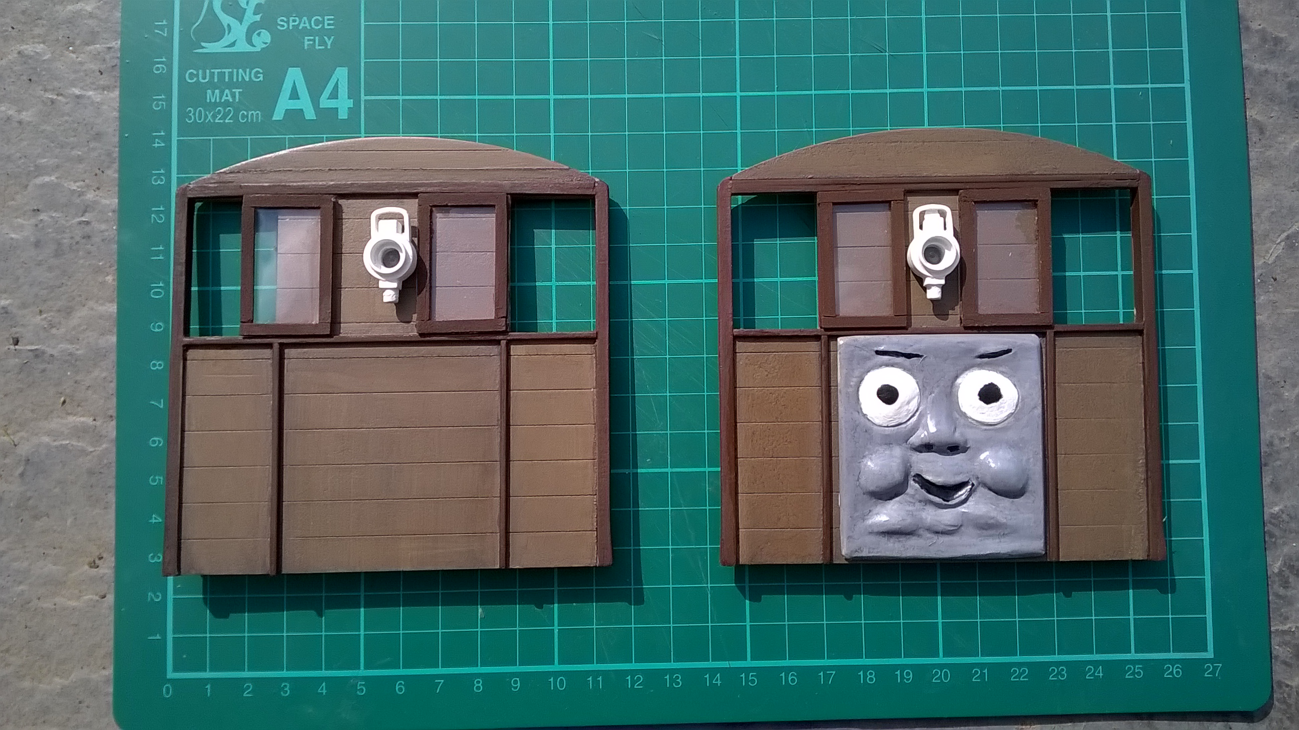 Adding Toby's face to the end panels.