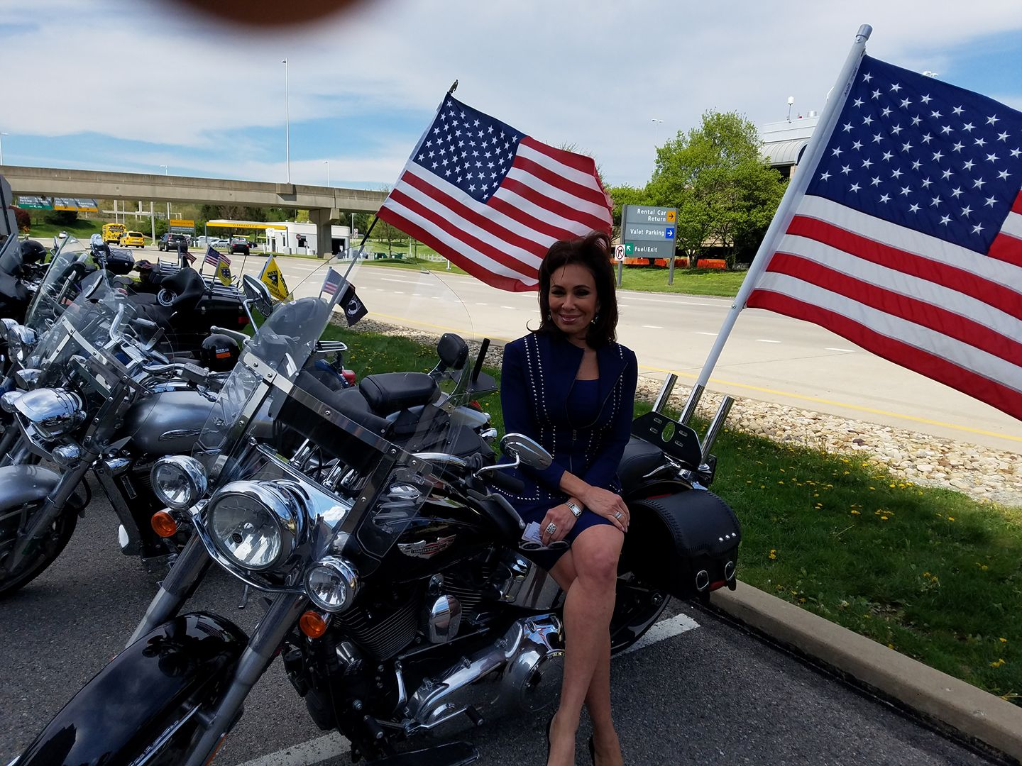 Judge Jeanine takes a pic on our members bike