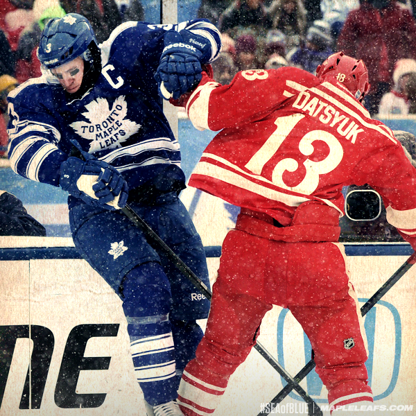 Dion Phaneuf and Pavel Datsyuk collide in the 2014 NHL Winter Classic