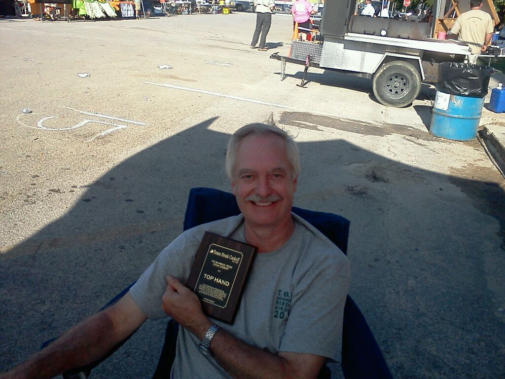 "Jerry Harkins, our illustrious sponsor, holding the ""Top Hand"" trophy at the Texas Steak Cookoff"" in Hico, Texas  May 19th, 2012!"
