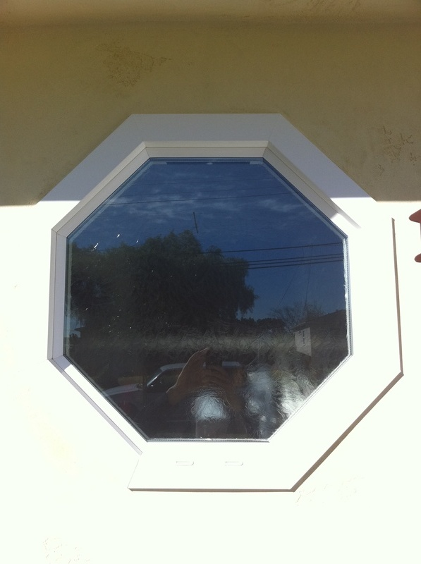 outside of octagon window with glue chip obscured glass