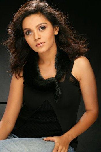 Ami Trivedi in black