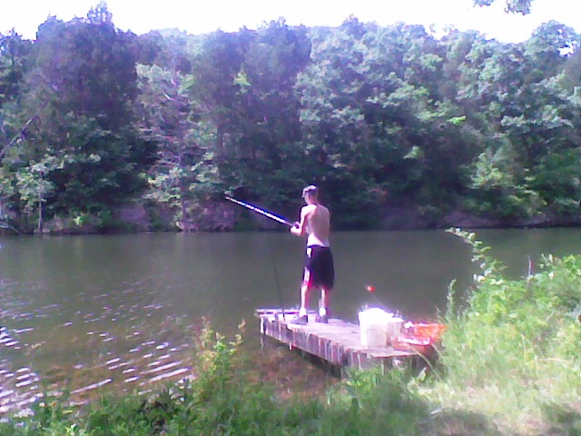 Max fishing  from our dock, 23 yrs of fun