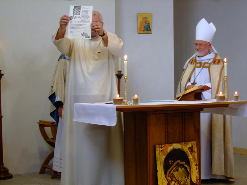 Br Geoff shows the Congregation the Signed Charter of his Profession