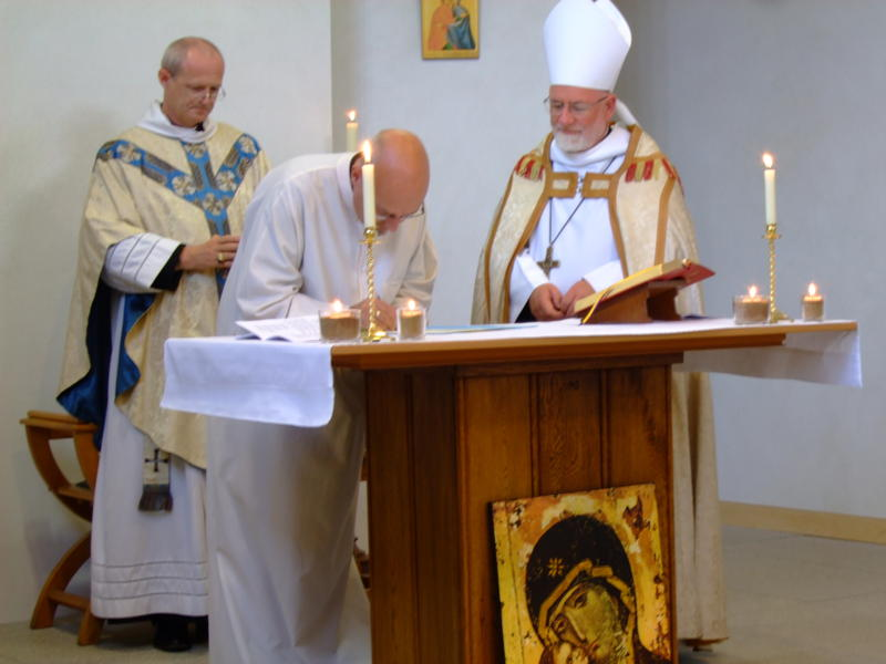 Br Philip signs his Charter of Profession