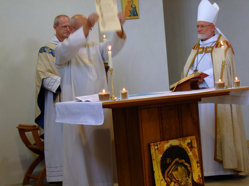 Br Philip shows the Congregation the Signed Charter of his Profession