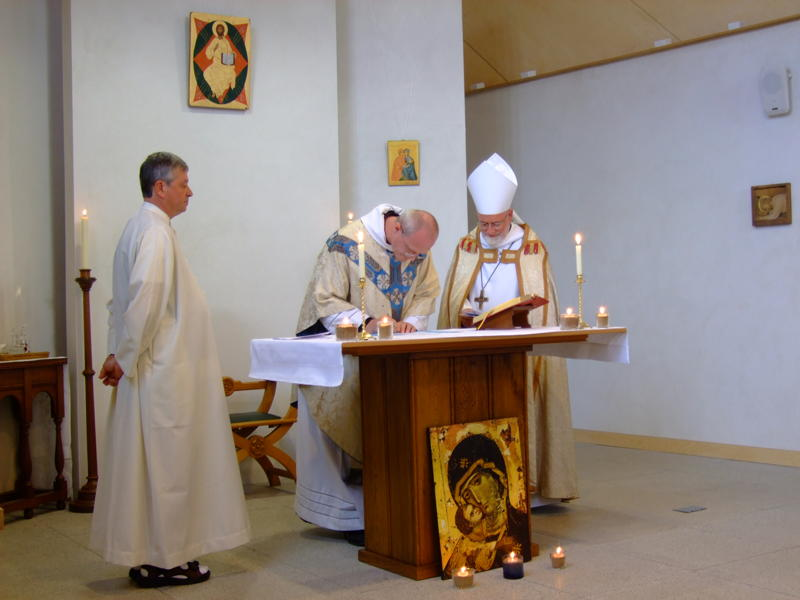 Bishop Mark (our Episcopal Visitor) countersigns Br Aelred's Charter of Profession
