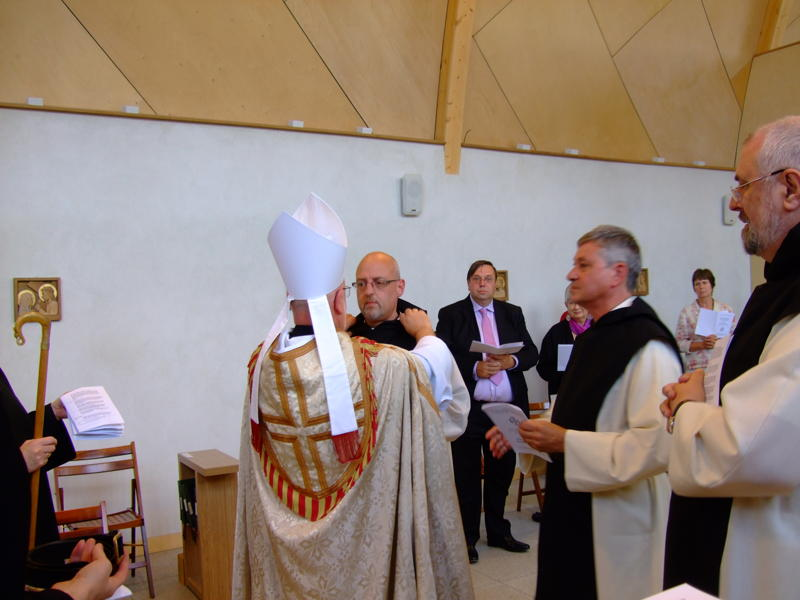 The Abbot vests Br Philip with his Scapular