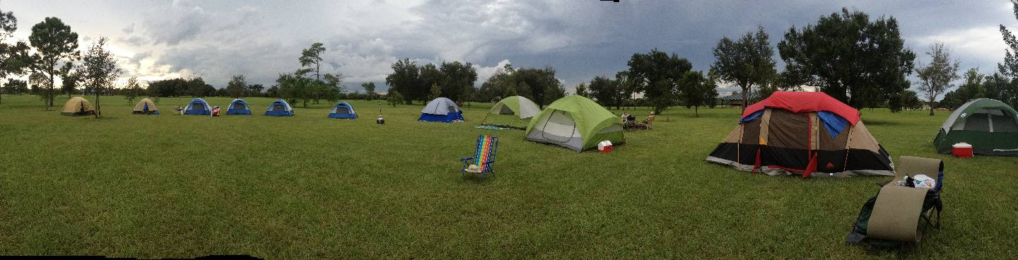 Wide shot of Scout tents and Adult tents